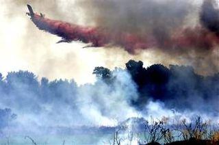 Israeli Planes fighting Fires over Northern Israel 2006 War