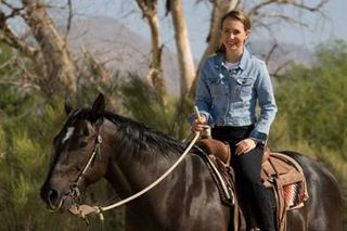 Gabrielle Giffords riding her Horse