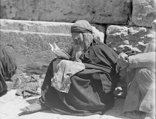 Jewish beggar reading Wailing Wall