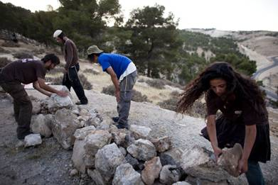 Israeli Males building Hilltop Settlement