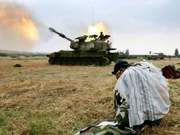 Haredi Israeli Soldier praying in Battle