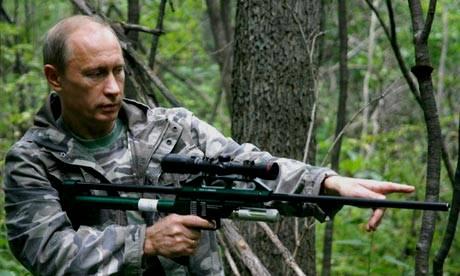 Russian President Vladmir Putin holding a Tranquilizer Gun
