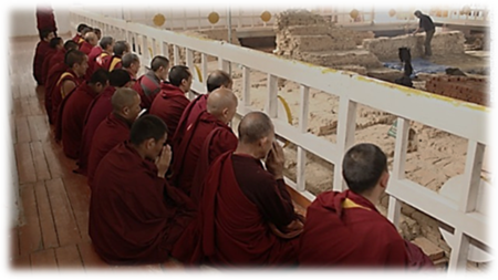 The Buddhist Monks praying at the Excavation Site at Maya Devi Temple