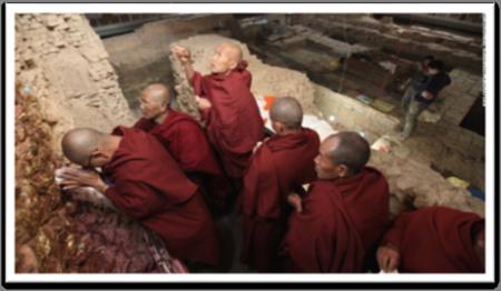 Buddha Monks praying at the Birth Site of the Saccai Mundi