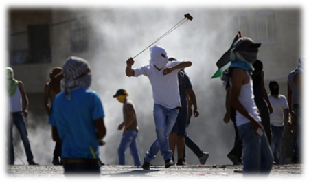 Palestinian protestor fire stones in Eastern Jerusalem