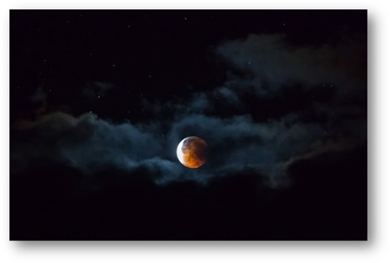 Dark Blood Moon hovers over North and South America