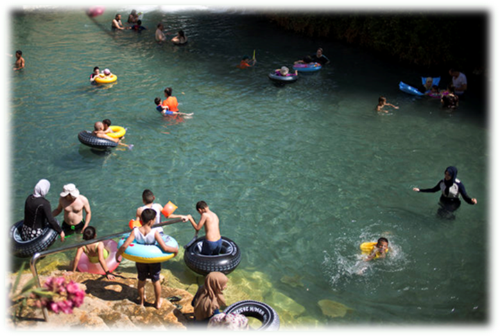 Jewish families cool off at the Gan HaShlosha National Park in Israel