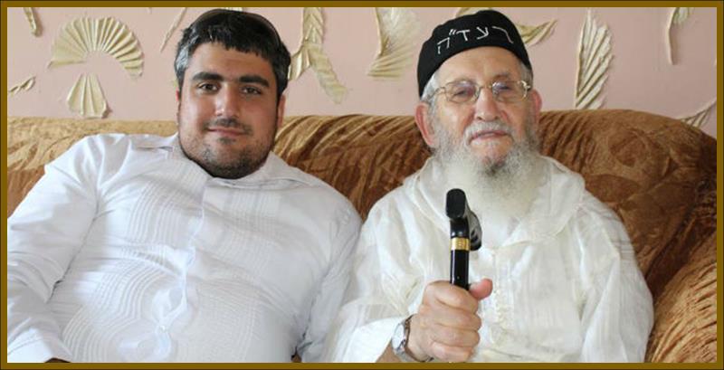 Rabbi Amram Vaknin sits with Gil Lewinsk
