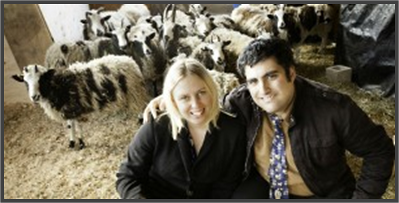 Gil and Jenna Lewinsky sit among a flock of Jacob's sheep