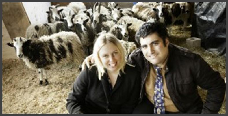 Gil and Jenna Lewinsky sit among a flock of Jacob's sheep