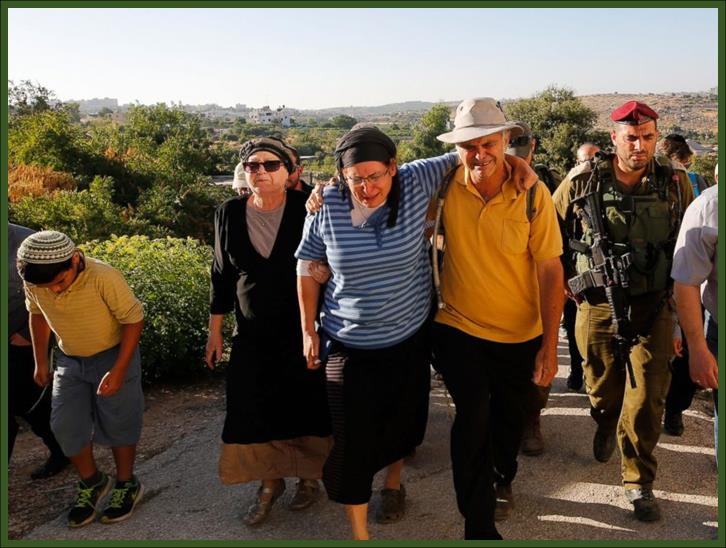 """Rina (2-L) and Amihay Yaffe Ariel (3-R) parents of Israeli Hallel A""""H, a 13-year-old girl"""