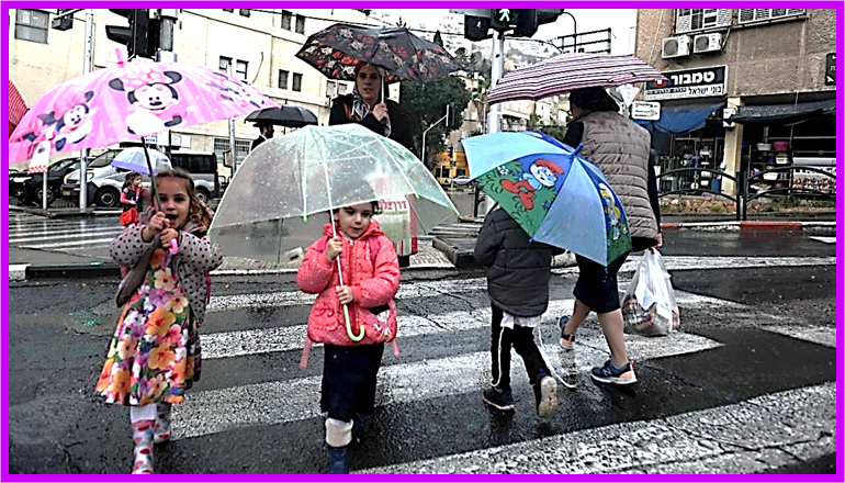 Children walking in the Early Rain in Haifa after Sukkot